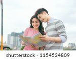 happy asian couple on vacation... | Shutterstock . vector #1154534809