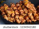 shish kebab in a frying pan.... | Shutterstock . vector #1154542180