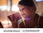 little girl lying on bed and... | Shutterstock . vector #1154544439