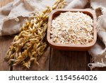 oatmeal flakes and ears of oats ... | Shutterstock . vector #1154564026