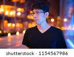 happy asian man thinking... | Shutterstock . vector #1154567986