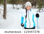 Cross-country skiing woman doing classic nordic cross country skiing in trail tracks in snow covered forest in Quebec, Canada - stock photo