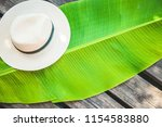 palm leaf  straw hat summer... | Shutterstock . vector #1154583880