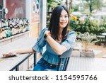 beautful young women sitting in ...   Shutterstock . vector #1154595766