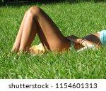 girl in bikini sunbathing in a... | Shutterstock . vector #1154601313