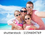 happy beautiful family on white ... | Shutterstock . vector #1154604769