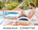 young bearded freelancer...   Shutterstock . vector #1154607760