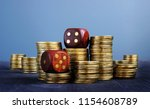 stacks of coins and dices.... | Shutterstock . vector #1154608789