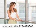 modern business woman near the... | Shutterstock . vector #1154623546