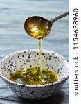 a freshly prepared salad sauce... | Shutterstock . vector #1154638960