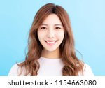 closeup young smiling woman face | Shutterstock . vector #1154663080