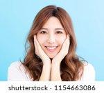 closeup smiling young asian...   Shutterstock . vector #1154663086