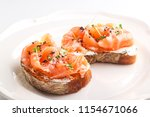 tasty bruschetta with salmon | Shutterstock . vector #1154671066