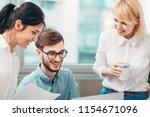 young intern receives feedback...   Shutterstock . vector #1154671096