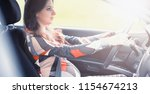 girl driving a car bad emotions ...   Shutterstock . vector #1154674213