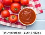 tomatoes and ketchup. top view. | Shutterstock . vector #1154678266