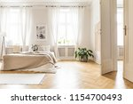 spacious and bright bedroom...   Shutterstock . vector #1154700493