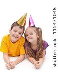 Party kids with colorful hats laying on the floor - stock photo
