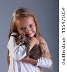 I love my kitten - little girl holding her new pet - stock photo
