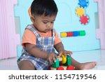 cute little baby boy lying play ... | Shutterstock . vector #1154719546