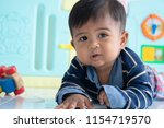 cute little asian baby boy... | Shutterstock . vector #1154719570