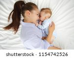portrait of a young mother and... | Shutterstock . vector #1154742526
