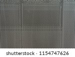 seamless tiling perforated... | Shutterstock . vector #1154747626
