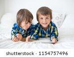 two preschool children  boy... | Shutterstock . vector #1154757496