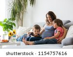 young pregnant woman  reading a ... | Shutterstock . vector #1154757616