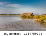 old cabin on the water in... | Shutterstock . vector #1154759173