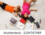 kids reading for school lying... | Shutterstock . vector #1154767489
