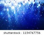holiday  christmas lights...   Shutterstock . vector #1154767756