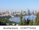 baku rise up the slopes of the... | Shutterstock . vector #1154771416