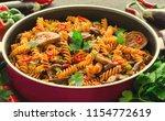 mediterranean eggplant pasta in ... | Shutterstock . vector #1154772619