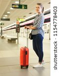 young woman with red suitcase... | Shutterstock . vector #1154778403