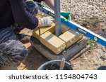 the worker lays bricks on the... | Shutterstock . vector #1154804743