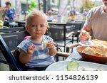 sweet baby boy  child eating... | Shutterstock . vector #1154826139