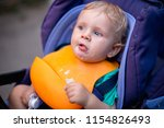 a small cute baby eats in a... | Shutterstock . vector #1154826493