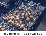 fried mushrooms on the grill. | Shutterstock . vector #1154826523