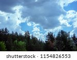 sky with clouds and the tops of ... | Shutterstock . vector #1154826553