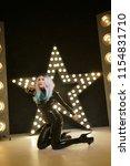 hot latex rubber woman posing... | Shutterstock . vector #1154831710