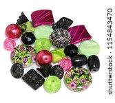 an exotic mix of pink  green  ... | Shutterstock . vector #1154843470