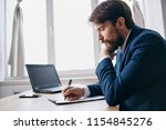 business man in a suit writes... | Shutterstock . vector #1154845276
