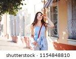 attractive caucasian woman is... | Shutterstock . vector #1154848810