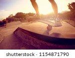 skateboarder skateboarding on... | Shutterstock . vector #1154871790