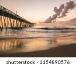 a golden sunrise reflected on... | Shutterstock . vector #1154890576