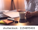 businesswoman sitting at her... | Shutterstock . vector #1154895403