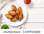 baked barbecue chicken wings... | Shutterstock . vector #1154924680