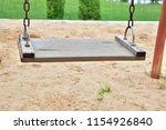 wood swings  swings chain... | Shutterstock . vector #1154926840