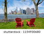 chairs on grass facing the...   Shutterstock . vector #1154930680